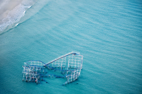 Rollercoaster partially submerged in ocean, Seaside Heights, New Jersey, USA