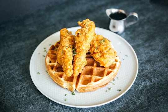 Chicken and Waffles on Dark Background
