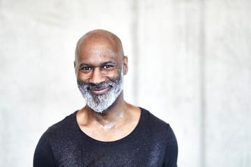 Portrait of sweating bald man with grey beard