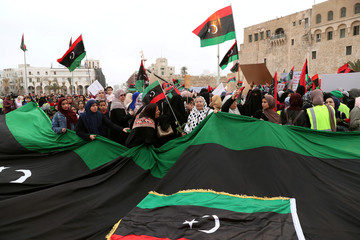 Women attend a demonstration to demand an end to the Khalifa Haftar's offensive against Tripoli, in Martyrs' Square in central Tripoli