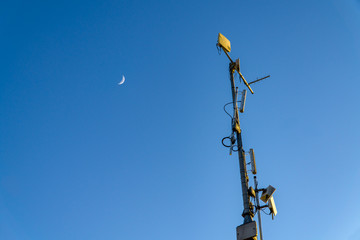Radio Mast and the Moon with blue sky