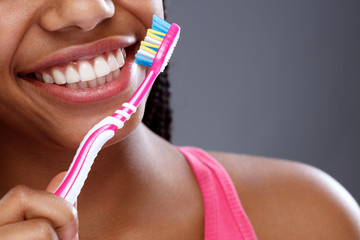 Oral hygiene with toothbrush in girl's hand, close up