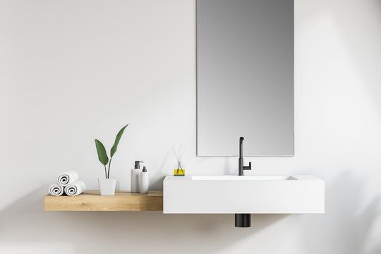 White bathroom sink with mirror