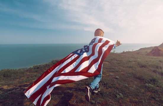 teen boy with american flag