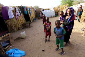 Internally displaced Sudanese children play within the Kalma camp for IDPs in Darfur