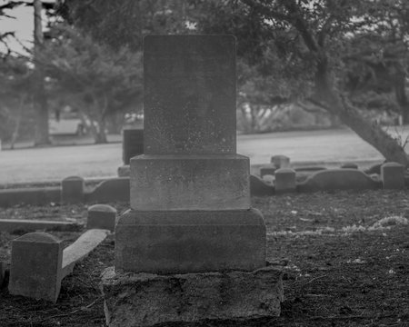 Put your name here. Halloween composition with tombstone in black and white with space for copy