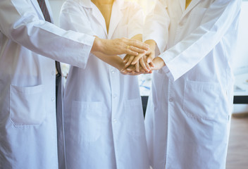 Scientists coordinate hands,Group of diversity people teamwork in laboratory,Successful and reserch working.