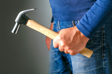 Family violence and aggression concept. Furious angry man with hammer. Family violence and aggression concept. Harassment.