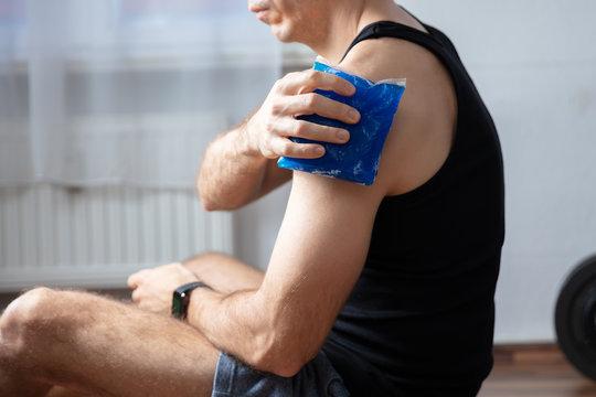 Man Applying Cool Gel Pack On His Shoulder