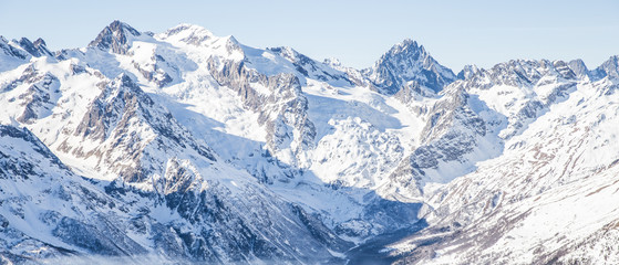 Wall Mural - Mauntain glacier panoramic view with blue sky and snow