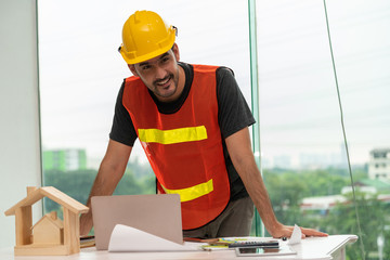 Construction engineer worker working in office. Real estate building contractor business concept.