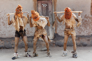 Traditional Nyau dancers with face masks at a Gule Wamkulu ceremony in a small village near Lilongwe, Malawi