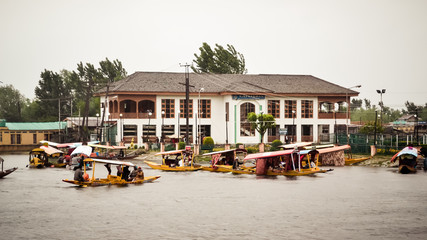Dal Lake Jammu Kashmir, India May 2018 - Dal lake called Srinagar's Jewel for tourism recreation center. It is a wetland floating Mughal gardens divide four basins Gagribal, Lokut Dal, Bod Dal, Nigeen
