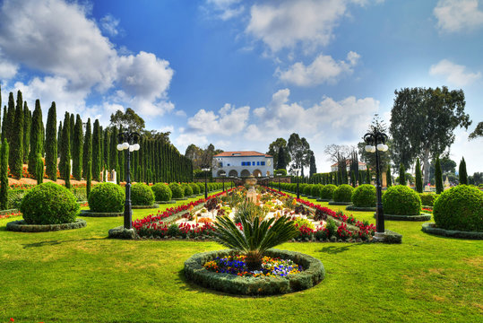 Beautiful colorful HDR image of the Bahai gardens at the Shrine of Bahaullah located in Bahji near Acre, Israel on blue cloudy sky