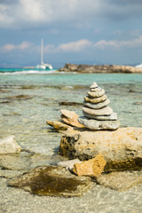 Balanced stones on the Illetes beach. Formentera, Spain.