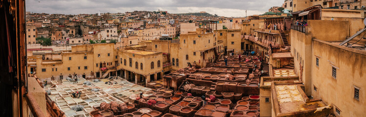 View inside of old medina in Fes, a traditional and old tannery with workers working making methods of leather in the city Fes, Morocco, in april of 2019.