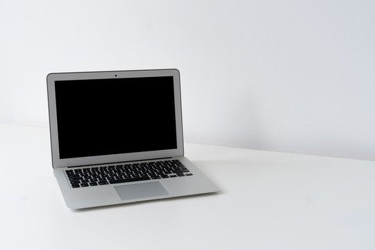 Open laptop on the desk with white background