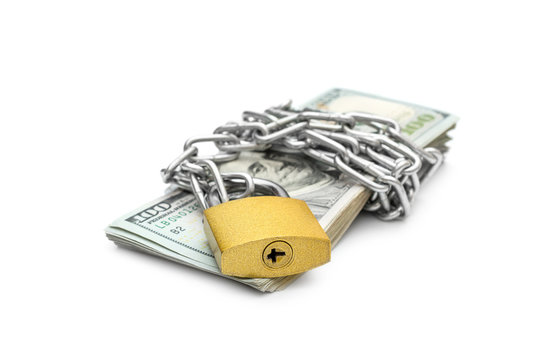 Stack of money wrapped by metal chain with padlock on white background.