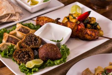 Arab Food, Kibe, Sfiha, Shish taouk, lemon, white sauce