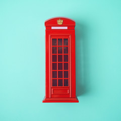 London red telephone booth on blue background.
