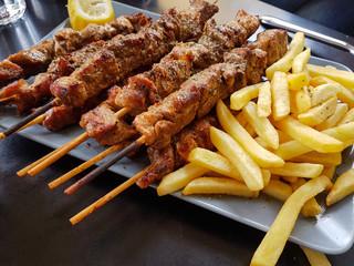 souvlaki or souvlakia greek etnic food meat roasted in a plate