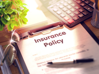 Insurance Policy Concept on Clipboard. 3D Rendering.
