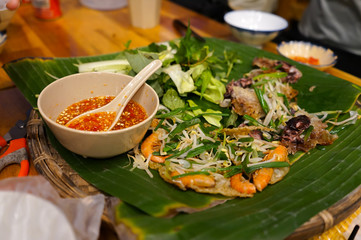Quy nhon famous street food called jumping shrimps pancakes or Banh xeo tom nhay