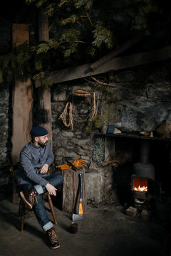 Man in front of fireplace