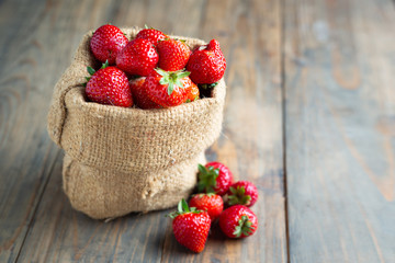 Fresh strawberries on wooden table.