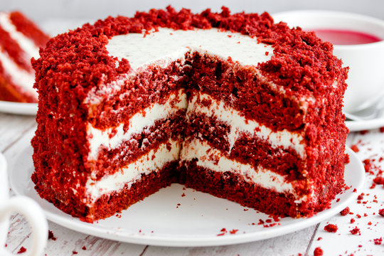 Red velvet cake, classic three layered cake from red butter sponge cakes with cream cheese frosting, American cuisine