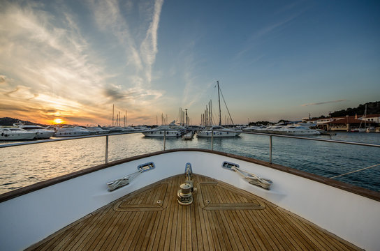 Wide angle shot of front of the yacht in marina in sunset