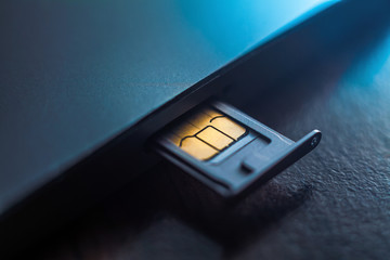 Sim card in tray being inserted into phone