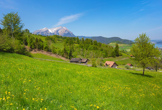 A springtime view from the foot of Mt. Stanserhorn in the Swiss canton of Nidwalden near the town of Stans, summit of Mt. Pilatus in the background.