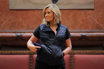 """A woman models a Peninsula Insulator Packable Vest during the """"Fashion & Firearms"""" concealed carry fashion show at the National Rifle Association (NRA) annual meeting in Indianapolis, Indiana"""