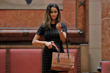 """A woman models a Cameleon Hephaestus Structured handbag during the """"Fashion & Firearms"""" concealed carry fashion show at the National Rifle Association (NRA) annual meeting in Indianapolis, Indiana"""