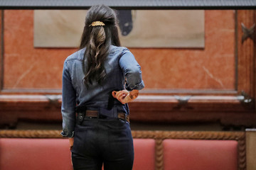 """A woman models Skinny Concealed Carry Jeans by Dark Alley Denim during the """"Fashion & Firearms"""" concealed carry fashion show at the National Rifle Association (NRA) annual meeting in Indianapolis, Indiana"""