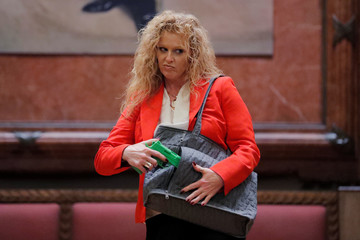 """A woman models the Julie Concealed Carry Handbag by Hiding Hilda during the """"Fashion & Firearms"""" concealed carry fashion show at the National Rifle Association (NRA) annual meeting in Indianapolis, Indiana"""