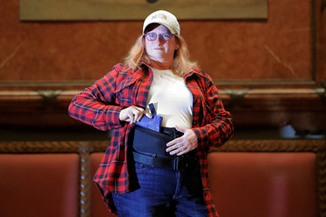 """A woman models the Tactica Flannel Shirt during the """"Fashion & Firearms"""" concealed carry fashion show at the National Rifle Association (NRA) annual meeting in Indianapolis, Indiana"""