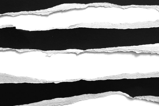 old torn black paper isolated on white background