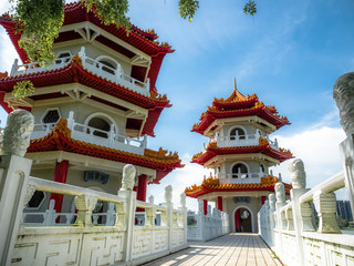 Singapore Nov 26, 2018: The Twin Pagodas on Jurong Lake, A beautiful chinese style building with blue sky in the Chinese Garden with cloudy sky in Singapore. Fototapete