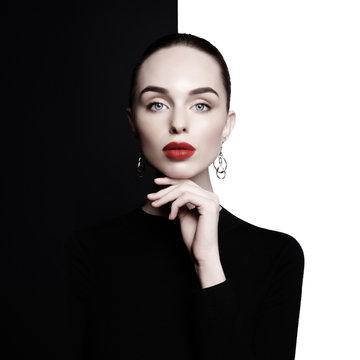 beautiful young woman with big earrings pose in studio