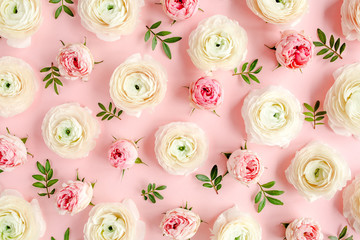Wall Mural - Floral background texture made of pink ranunculus and roses flower buds on pink background.  Flat lay, top view floral background.