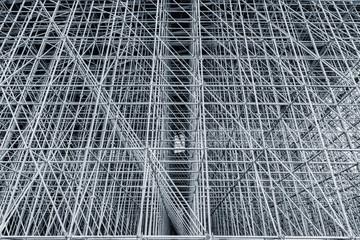 Vertical scaffolding formed a myriad of grid.
