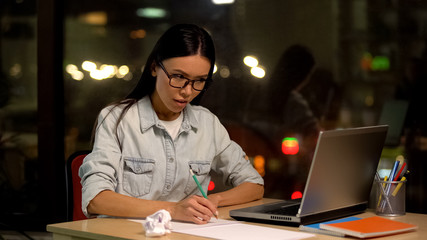 Female designer drawing sketches looking laptop, educational online lesson