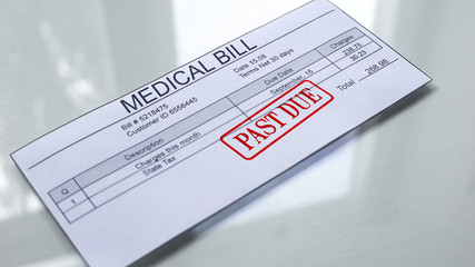 Medical bill past due, seal stamped on document, payment for services, insurance