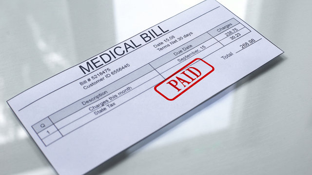 Medical bill paid, seal stamped on document, payment for services, tariff