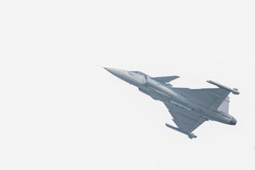 The Gripen plane above the horizon