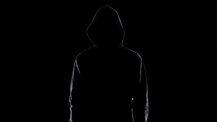 Dangerous anonymous male in night darkness, scary terrorist preparing for crime Wall mural