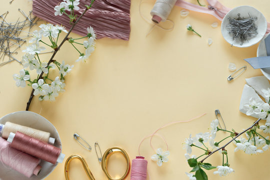 image of pink fabric and sewing tools, top view