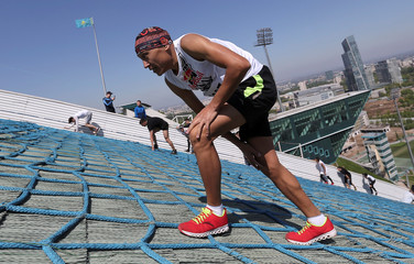 Athletes compete during the Red Bull 400 uphill sprint at the Sunkar International Ski Jumping Complex in Almaty